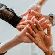 Hands stacked together - Empowerment
