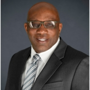 Official photo of Assistant District Attorney Dwain Woodley.
